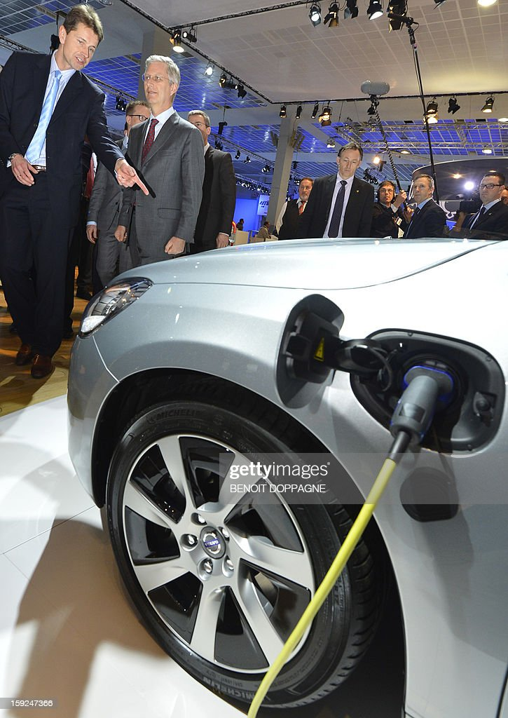 Crown Prince Philippe of Belgium (2nd L) attends the official inauguration of the 91th edition of the European Motorshow in Brussels, on January 10, 2013, at the Brussels Expo. The Motorshow will open to the public from January 11 to 20.