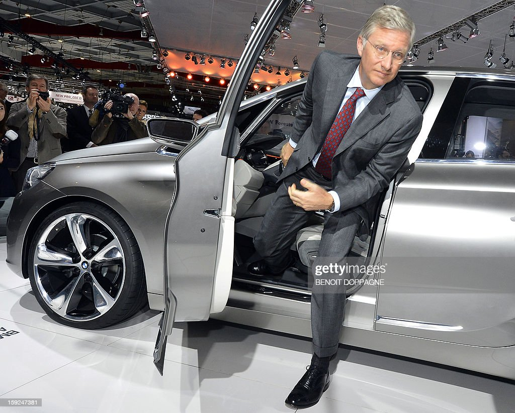 Crown Prince Philippe of Belgium attends the official opening of the 91th edition of the European Motorshow in Brussels, on January 10, 2013, at the Brussels Expo. The Motorshow will open to the public from January 11 to 20. AFP PHOTO / BELGA / BENOIT DOPPAGNE