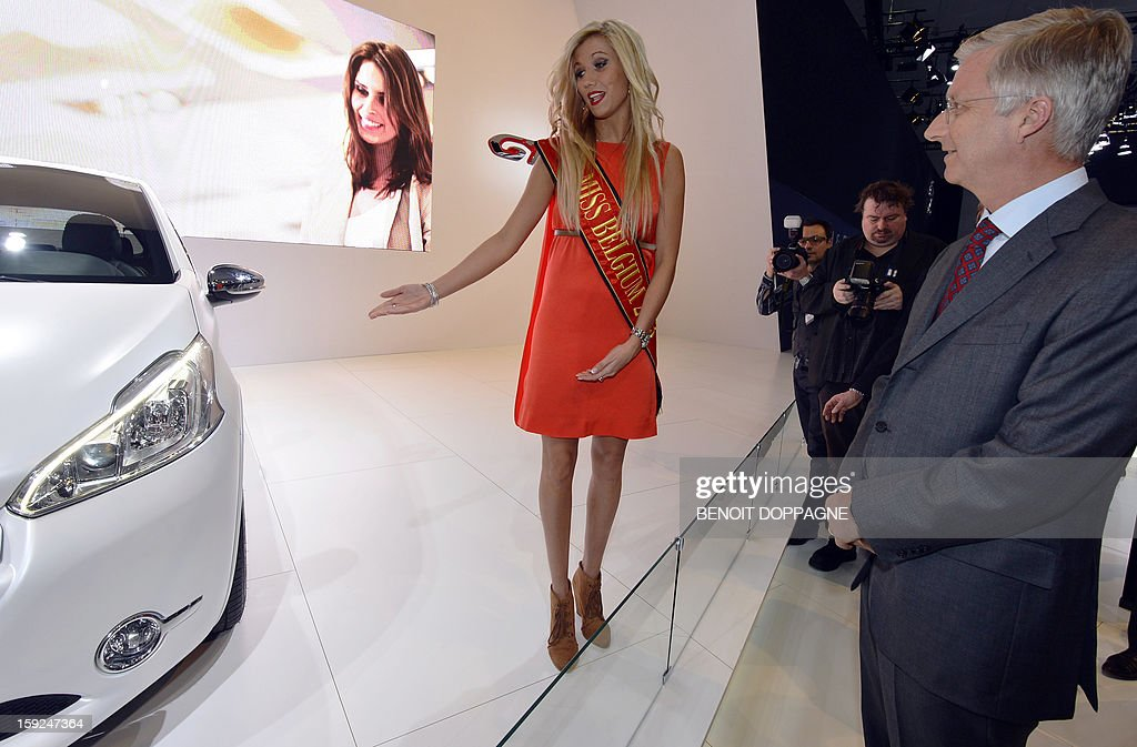 Crown Prince Philippe of Belgium (R) meets Miss Belgium 2013 Noemie Happart at the Peugeot stand during the official inauguration of the 91th edition of the European Motorshow in Brussels, on January 10, 2013, at the Brussels Expo. The Motorshow will open to the public from January 11 to 20.