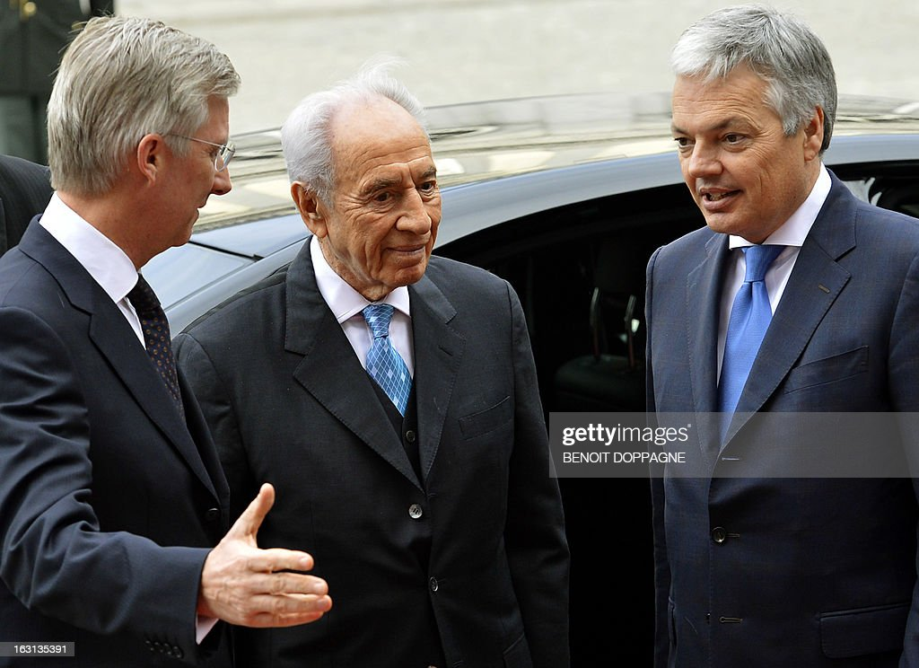 Crown Prince Philippe of Belgium welcomes Israel President Shimon Peres with Vice-Prime Minister and Foreign Minister Didier Reynders, on the first day of the visit of Shimon Peres to Belgium on March 5, 2013 at the Egmont Palace in Brussels.