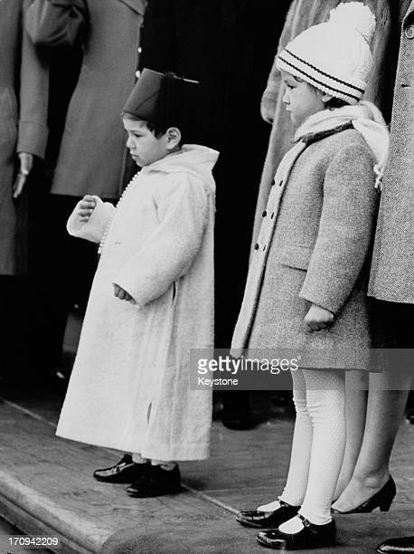 Crown Prince Sidi Mohammed and his sister Princess Lalla Meryem on the north portico of the White House as their father King Hassan II of Morocco is...
