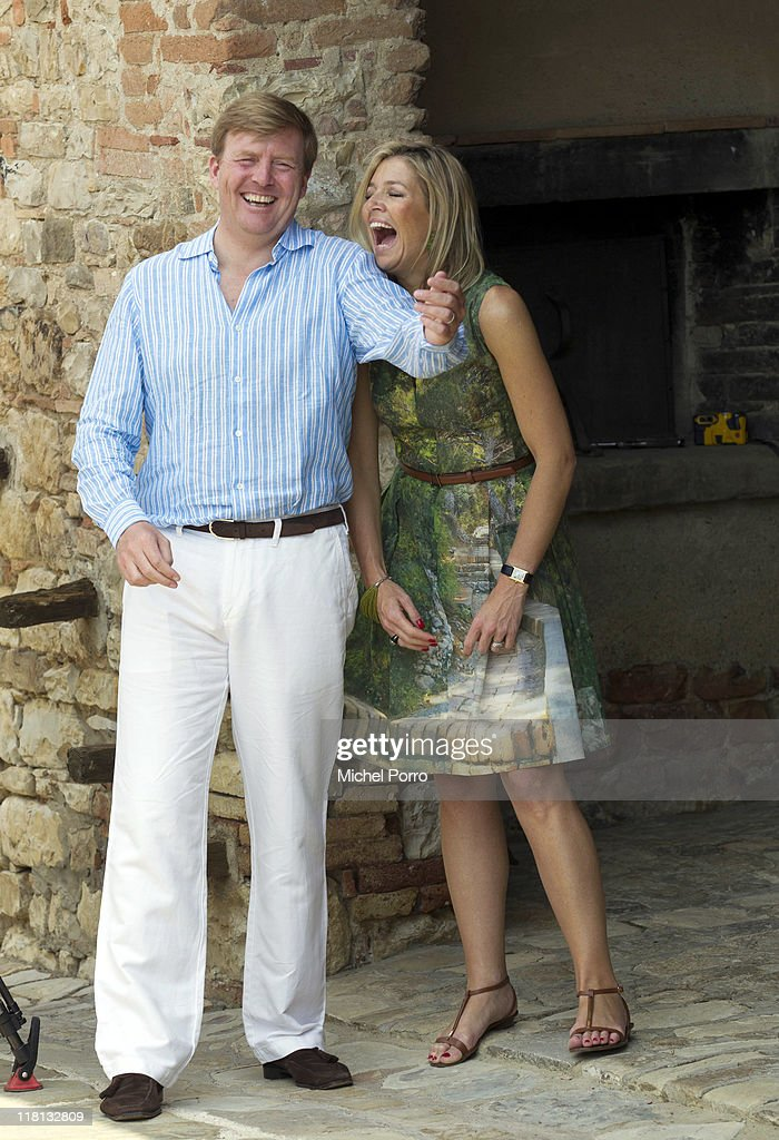 Crown Prince Willem-Alexander and Princess Maxima of the Netherlands laugh during a photo session on July 4, 2011 in Tavernelle, Italy.