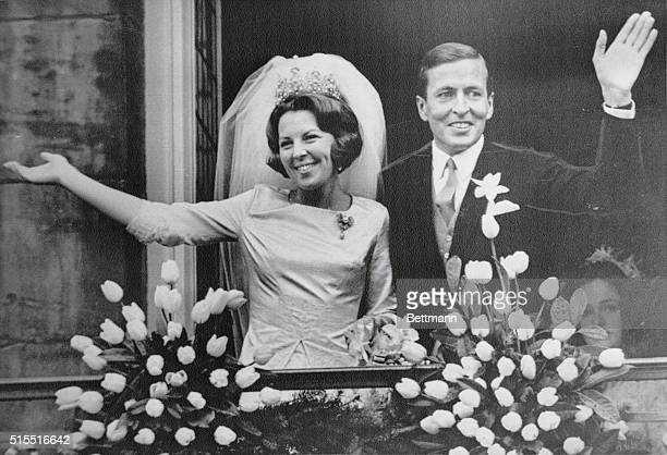 Crown Princess Beatrix and her husband Claus Von Amsberg wave from a balcony of the Royal Palace following their wedding on March 10 1966 in Amsterdam