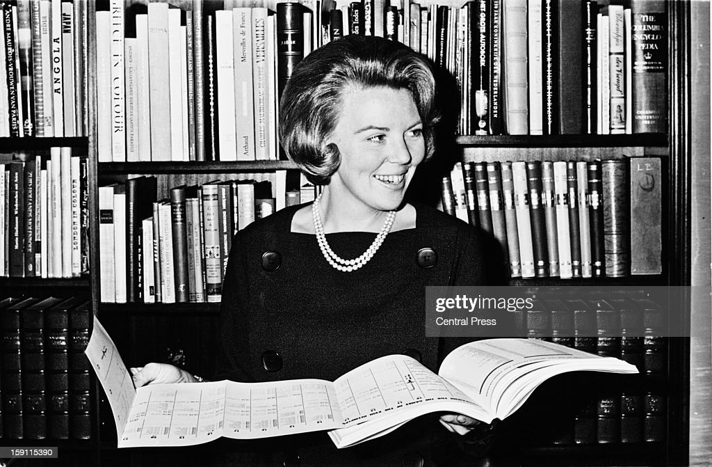 Crown Princess Beatrix later Queen Beatrix of the Netherlands holding the programme for the 1964 Summer Olympics in her office Netherlands 27th...