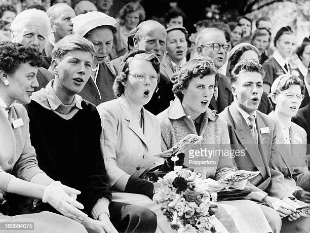 Crown Princess Beatrix of the Netherlands singing at a youth sports event at the Olympiaplein sports ground during her first official visit to...