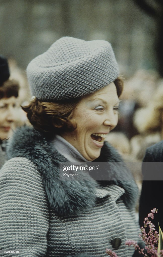 Crown Princess Beatrix of the Netherlands wearing a hat and fur stole while laughing, 1980.