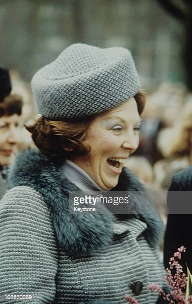 Crown Princess Beatrix of the Netherlands wearing a hat and fur stole while laughing 1980