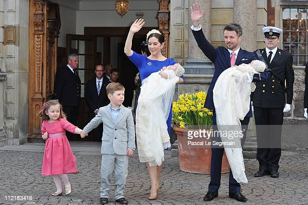 Crown Princess Mary and Crown Prince Frederik of Denmark with Princess Isabella and Prince Christian wave afterthe christening of their twins Prince...