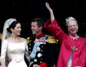 Crown Princess Mary and Crown Prince Frederik share a laugh as Queen Margrethe II of Denmark waves to the crowd as the Royal couple appear on the...