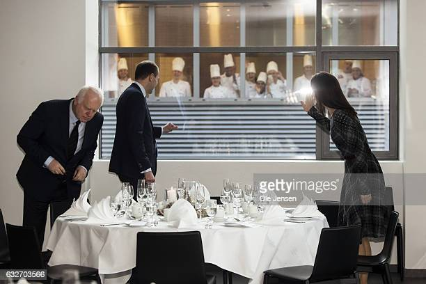 Crown Princess Mary and Icelandic President Gudni Thorlacius Johannesson wave to chefs students during their visitto Copenhagen Hospitality School on...
