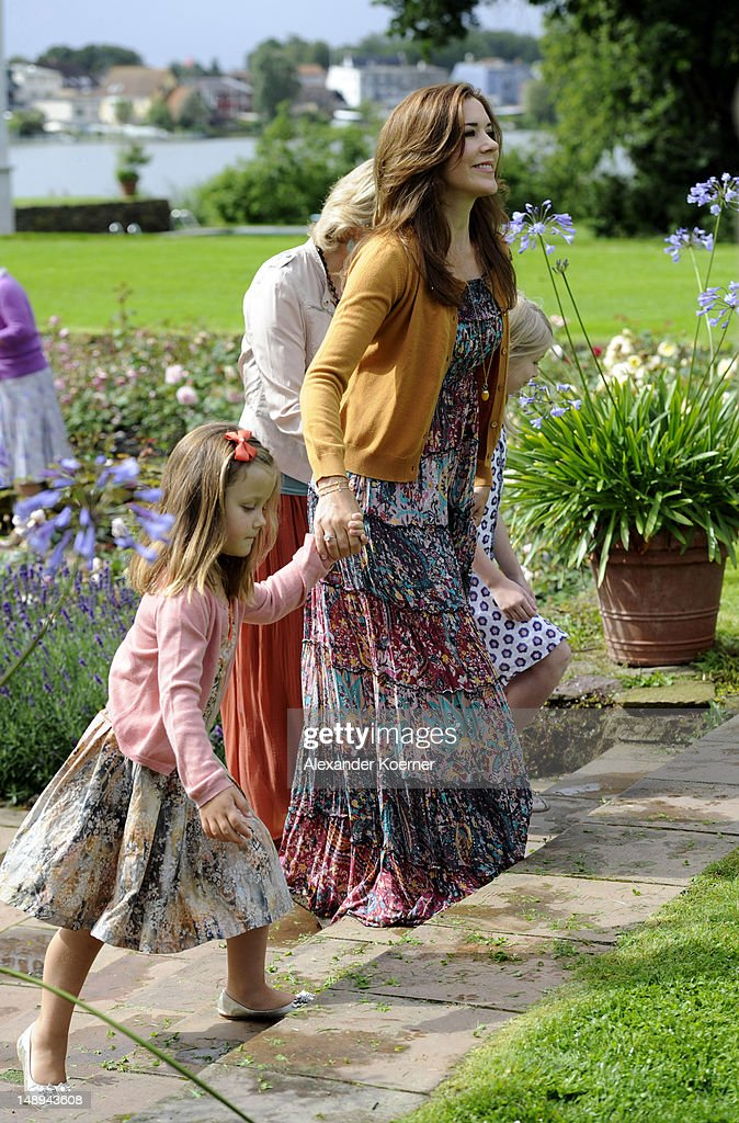 Crown Princess Mary and Princess Isabella pose during a photocall for the Royal Danish family at their summer residence of Grasten Slot on July 20, 2012 in Grasten, Denmark.