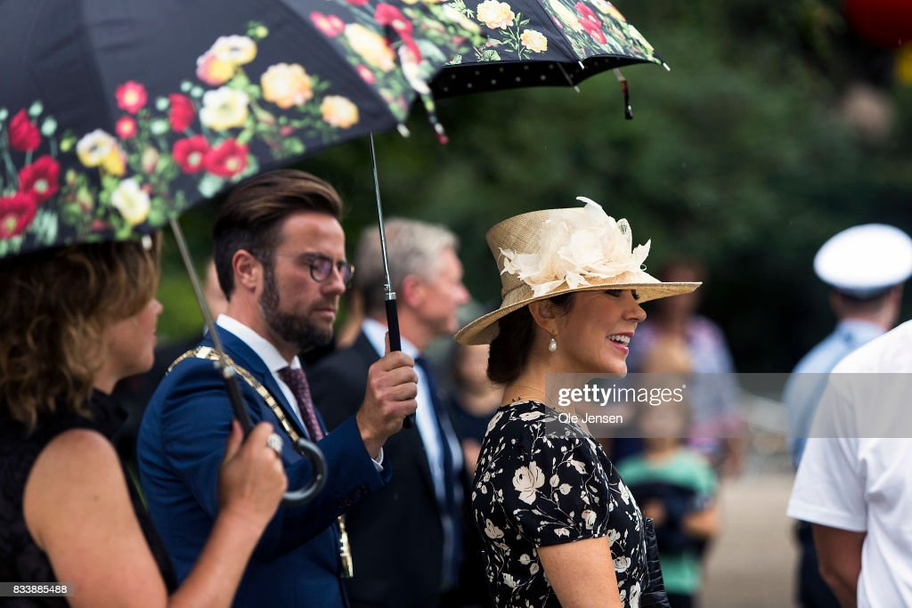 Crown Princess Mary (R) attends Odense Flower Festival which she is to open officially and where she is to be presented to a new developed rose on August 17, 2017 in Odense, Denmark. The Crown Princess is accompanied by festival responsible Henrietta Rasmussen (L) and mayor Peter Rhabaek (L - 2nd). The festival opens today and ends August 20 and takes place all over the inner city with some 100.000 plants made up with the theme 'What a Woinderful World' and urban gardening.
