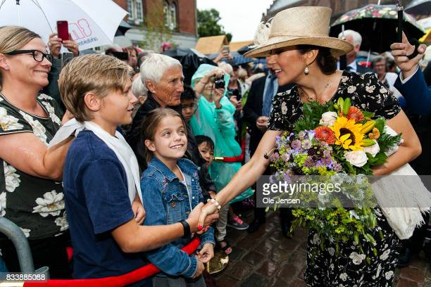 Crown Princess Mary greet spectators at Odense Flower Festival which she is to open officially and where she is to be presented to a new developed...