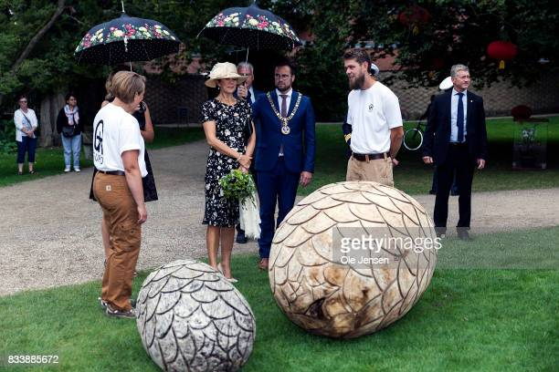 Crown Princess Mary is presented to garden art cut in wood by the company Guro during her visit to Odense Flower Festival which she is to open...