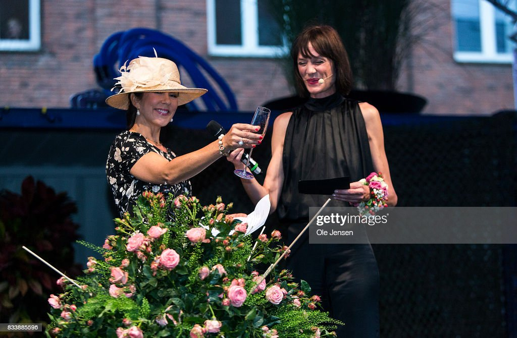 Crown Princess Mary (L) name a new developed rose during the opening ceremony of Odense Flower Festival on August 17, 2017 in Odense, Denmark. The new rose is named after the theme of the festival 'What a Wonderful World', is remontant and developed by Rosa Eskelund. The festival opens today and ends August 20 and takes place all over the inner city with some 100.000 plants made up with the theme 'What a Woinderful World' and urban gardening.