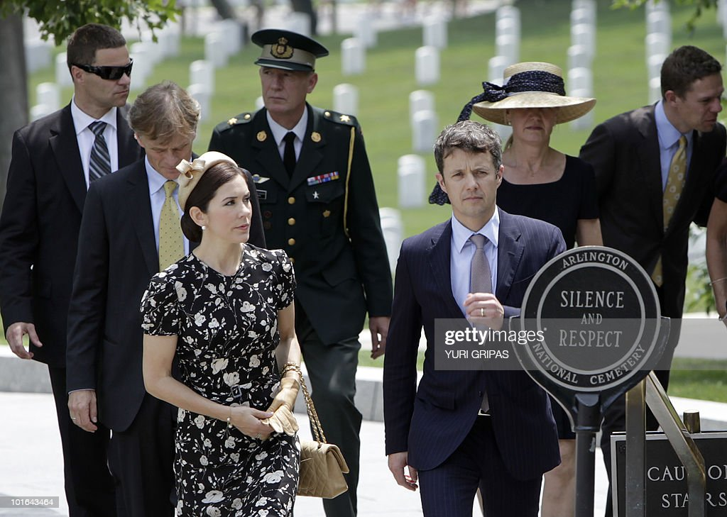 Crown Princess Mary of Denmark (L) and Crown Prince Frederik of Denmark (R) are given a tour at Arlington National Cemetery in Arlington, Virginia on June 5, 2010.