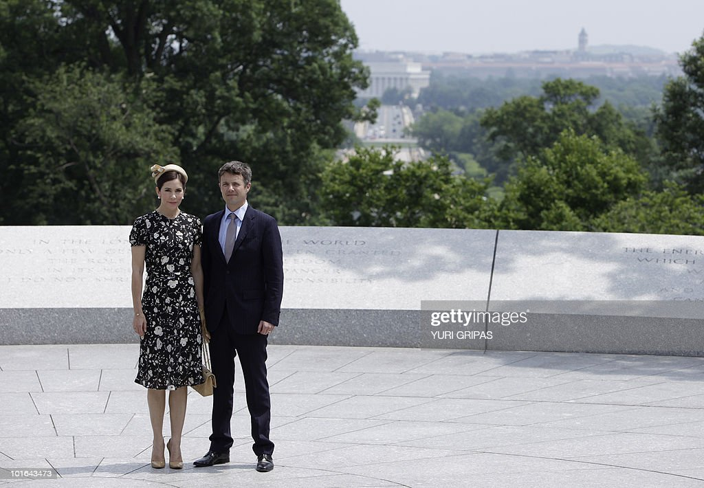 Crown Princess Mary of Denmark (L) and Crown Prince Frederik of Denmark (R) pose for a picture with the Lincoln Memeorial in Washington in the background as they are given a tour at Arlington National Cemetery in Arlington, Virginia on June 5, 2010.