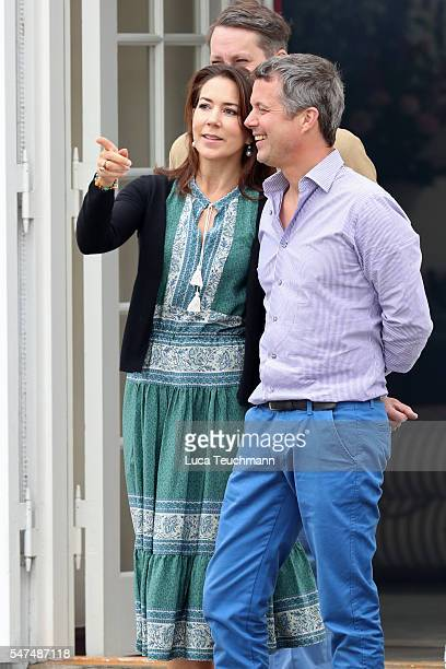 Crown Princess Mary of Denmark and Crown Prince Frederik of Denmark watch their kids play during the annual summer photo call for The Danish Royal...