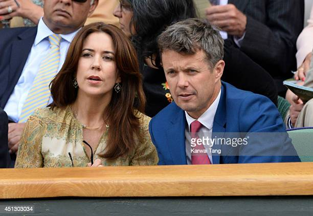 Mary Crown Princess of Denmark and Frederik Crown Prince of Denmark attend the Gilles Muller v Roger Federer match on centre court during day four of...