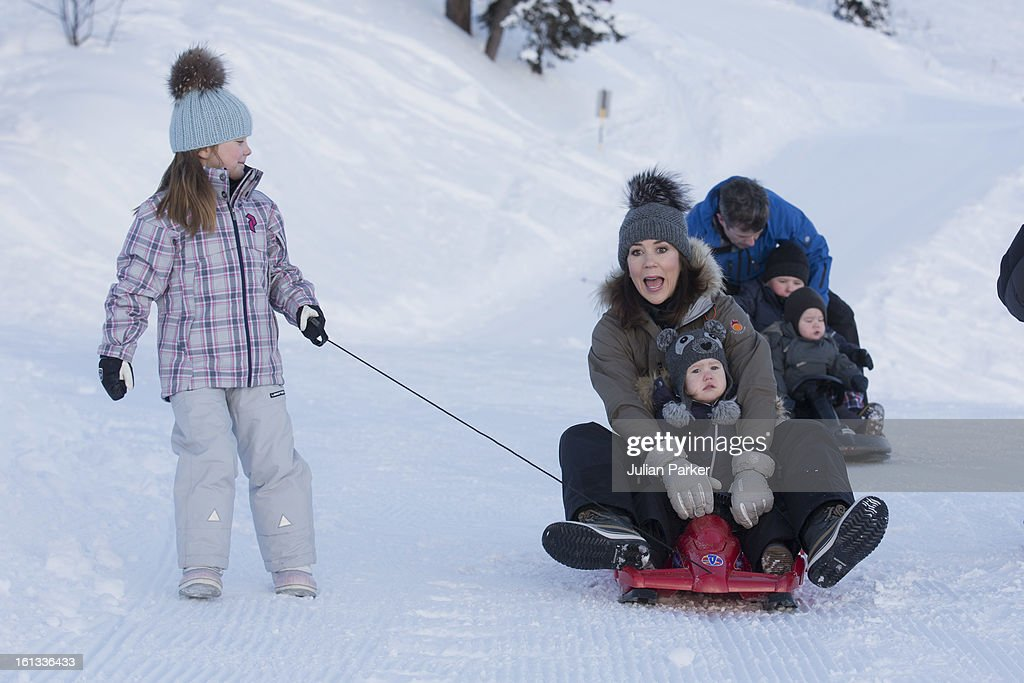 Crown Princess Mary of Denmark and Princess Josephine of Denmark ( on sledge ), and Princess Isabella of Denmark, pose for photographs on their annual skiing holiday on February 10, 2013 in Verbier, Switzerland.