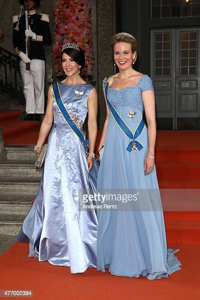 Crown Princess Mary Of Denmark and Queen Mathilde of Belgium depart after the royal wedding of Prince Carl Philip of Sweden and Sofia Hellqvist on...