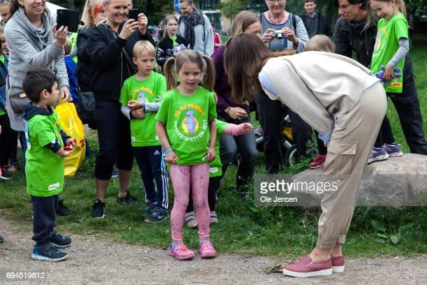 Crown Princess Mary of Denmark arrives to the 'Children's Relay Run' in Faelledparken on June 10 2017 in Copenhagen Denmark The kids relay run is...