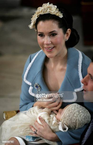 Crown Princess Mary of Denmark cradles her son and heir to the Danish throne Crown Prince Christian of Denmark as her husband Crown Prince Frederik...