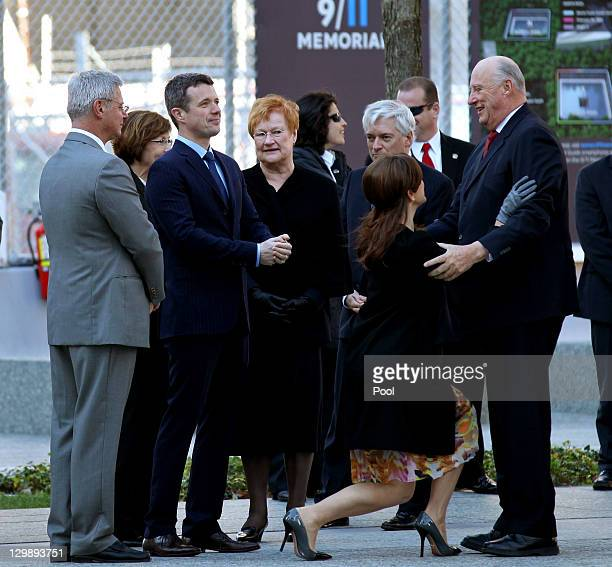 Crown Princess Mary of Denmark curtsies to King Harald of Norway as they arrive for a tour and ceremony at the National September 11 Memorial October...