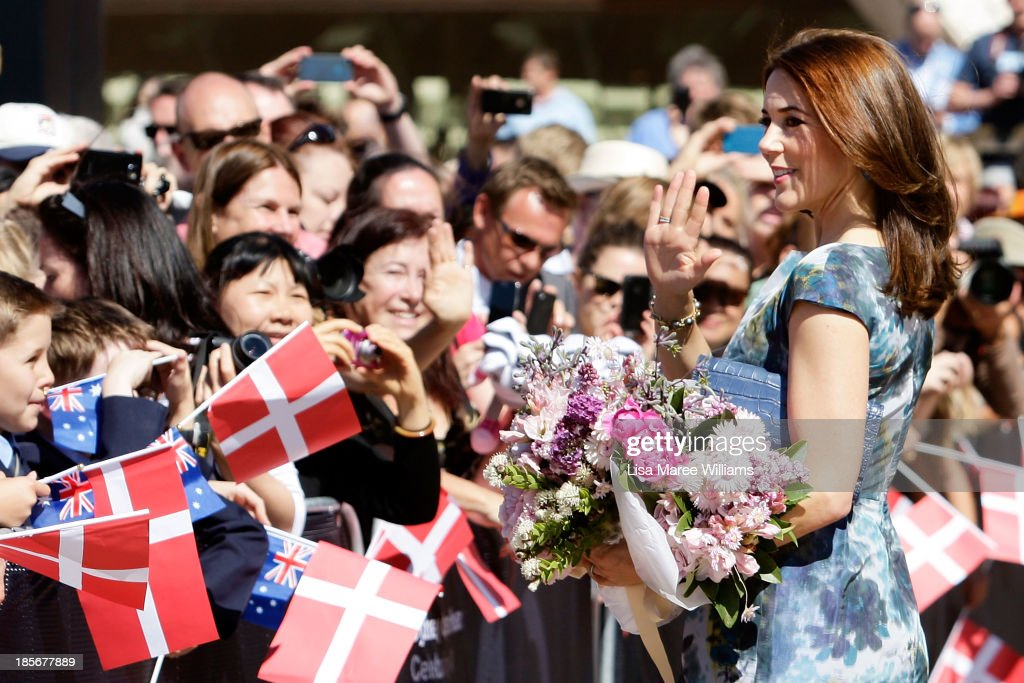 Crown Princess Mary of Denmark greets members of the public at the Opera House forecourt on October 24, 2013 in Sydney, Australia. Prince Frederik and Princess Mary will visit Sydney for five days and will attend events to celebrate the 40th anniversary of the Sydney Opera House and the Danish architect who designed the landmark, Jorn Utzen.