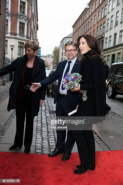 Crown Princess Mary of Denmark is welcomed by Mother's Aid Director Mads Roke Clausen as she visits the Danish Mother's Aid's new family counsel...