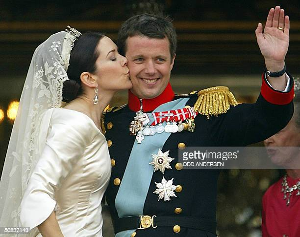 Crown princess Mary of Denmark kisses her husband Crown prince Frederik on the balcony at Amalienborg castle to the cheer of thousands in Copenhagen...