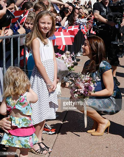 Crown Princess Mary of Denmark meetsschool children on the Opera House forecourt on October 24 2013 in Sydney Australia Prince Frederick and Princess...