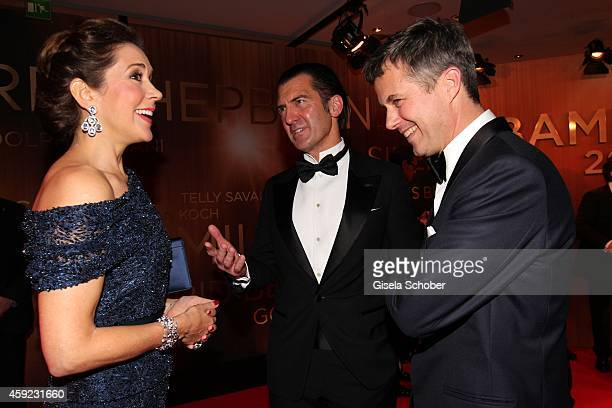 Crown Princess Mary of Denmark Philipp Welte and Crown Prince Frederik von Denmark speak during the Bambi Awards 2014 on November 13 2014 in Berlin...