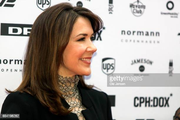 Crown Princess Mary of Denmark poses at the red carpet during the world premiere of the documentary 'Jaha's Promise' in the Grand Theatre during the...