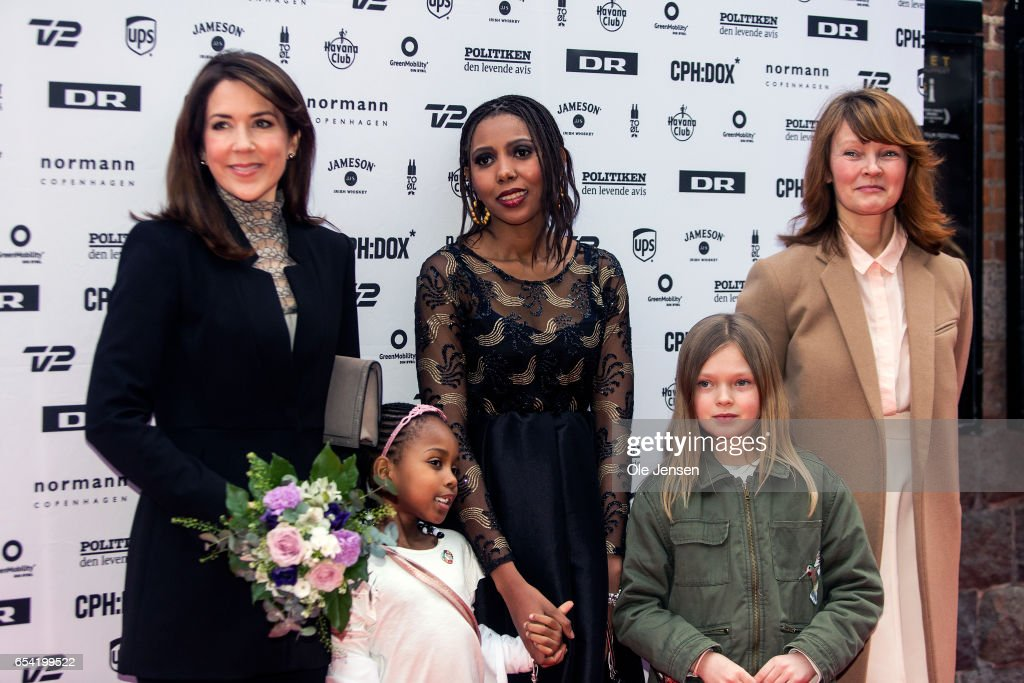 Crown Princess Mary of Denmark (L) poses on the red carpet together with Jaha Dukureh (C) and director for