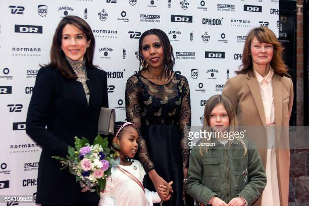 Crown Princess Mary of Denmark poses on the red carpet together with Jaha Dukureh and director for CPHDOX Tine Fischer at the world premiere of the...