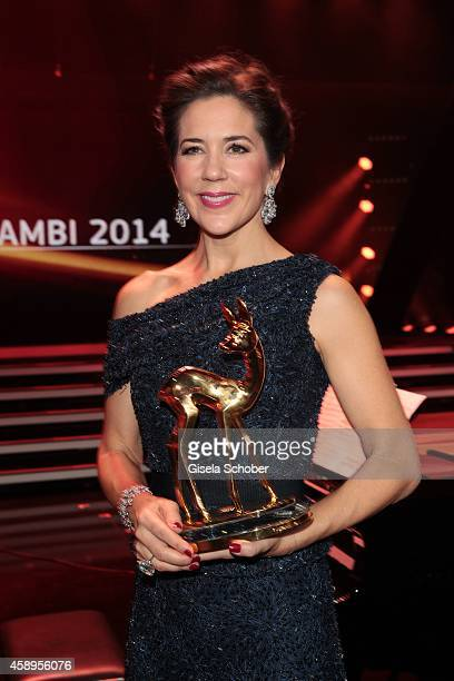 Crown Princess Mary of Denmark poses with her award during the Bambi Awards 2014 show on November 13 2014 in Berlin Germany