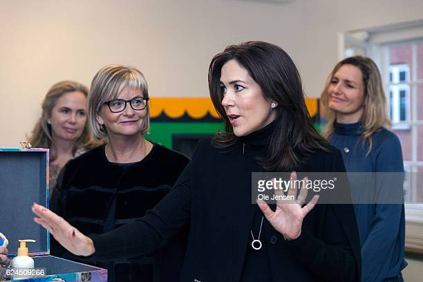Crown Princess Mary of Denmark speaks with therapists who explain how they work with children affected by domestic violence through the use of games...
