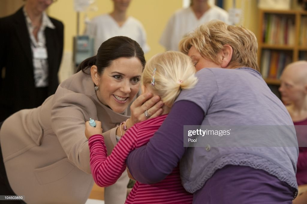 Crown Princess Mary of Denmark talks to childs during her visit at the cancer uni-clinic for kids and teenager on September 28, 2010 in Rostock, Germany. Frederik and Mary are on a two-day visit to northern Germany.