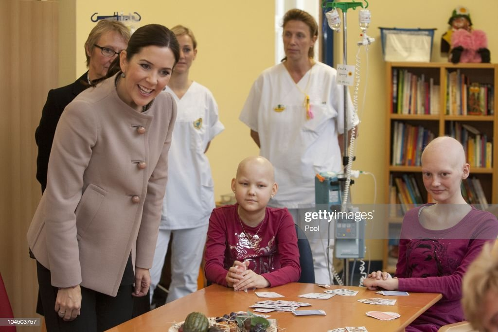 Crown Princess Mary of Denmark talks to Corinna Diederich (9) and Jenny Lentz (17) during her visit at the cancer uni-clinic for kids and teenager on September 28, 2010 in Rostock, Germany. Frederik and Mary are on a two-day visit to northern Germany.