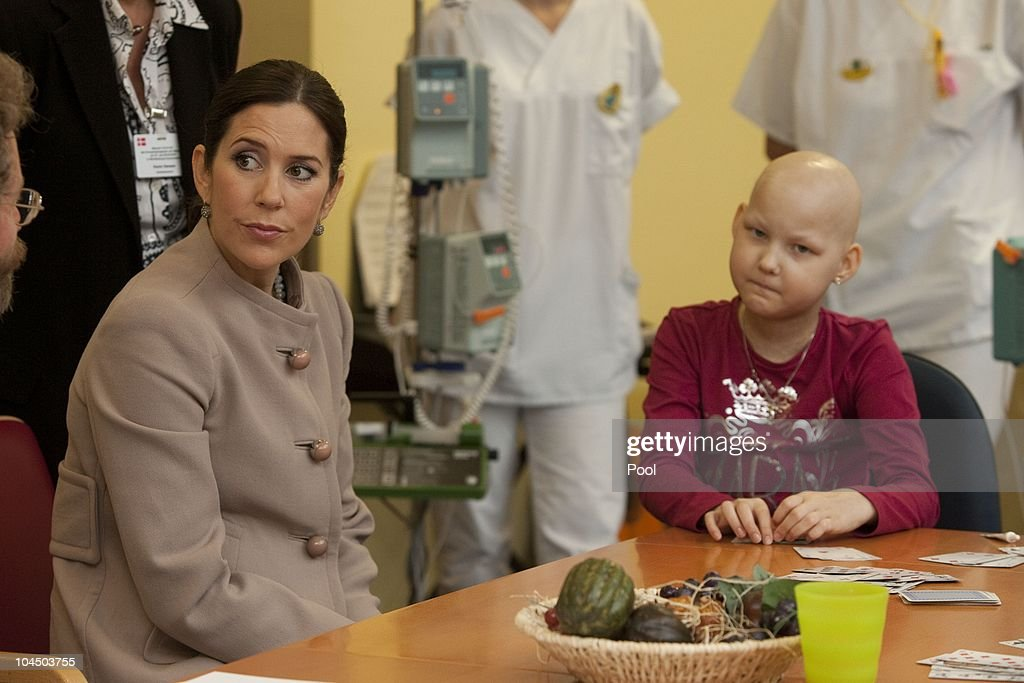 Crown Princess Mary of Denmark talks to Corinna Diederich (9) during her visit at the cancer uni-clinic for kids and teenager on September 28, 2010 in Rostock, Germany. Frederik and Mary are on a two-day visit to northern Germany.