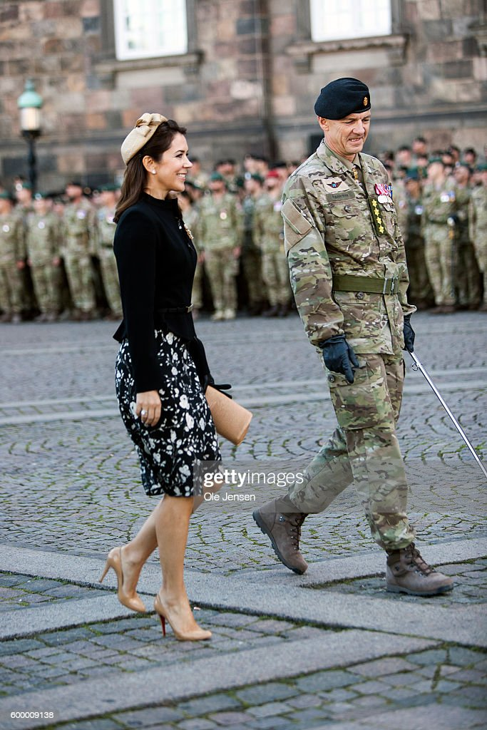 Crown Princess Mary of Denmark walks with Chief of Defence, General Peter Bartram, during her participation in the Flag Day parade for international deployed military personel, veterans and those lost in action at The Parliament Square (Danish, read: Christiansborg Slotsplads) in Copenhagen, Denmark on Septemnber 05, 2016.