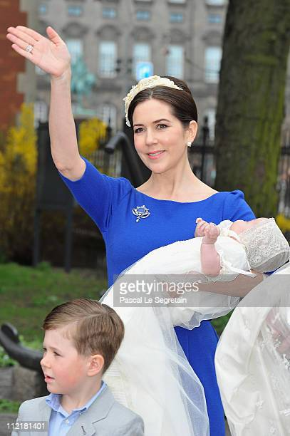 Crown Princess Mary of Denmark waves to the crowd as she arrives to attend the christening of her twins at Holmens Kirke on April 14 2011 in...