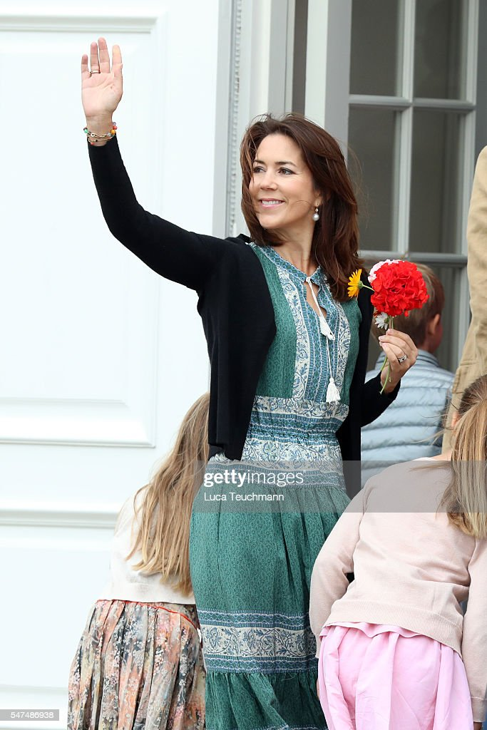 Crown Princess Mary of Denmark waves to the photographers at the annual summer photo call for The Danish Royal Family at Grasten Castle on July 15, 2016 in Grasten, Denmark.