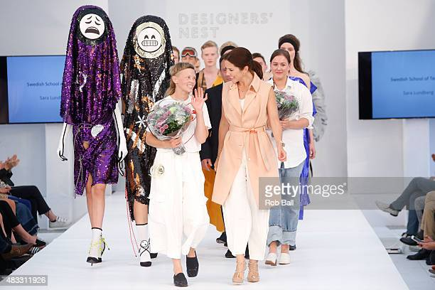 Crown Princess Mary of Denmark with Designers nest winner Sara Lundberg during the third day of Copenhagen Fashion Week Spring/Summer 2016 on August...