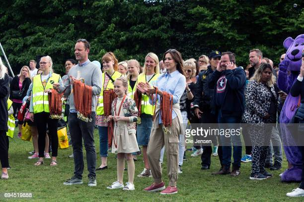 Crown Princess Mary of Denmark with medals around her arm together with Amanda winner of the Danish Junior European Song Contest 2017 cheer for the...