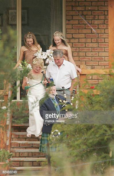 Crown Princess Mary of Denmark's cousine Alison Donaldson's walks to her marriage ceremony March 13 2005 in Swansea Australia Crown Prince Frederik...