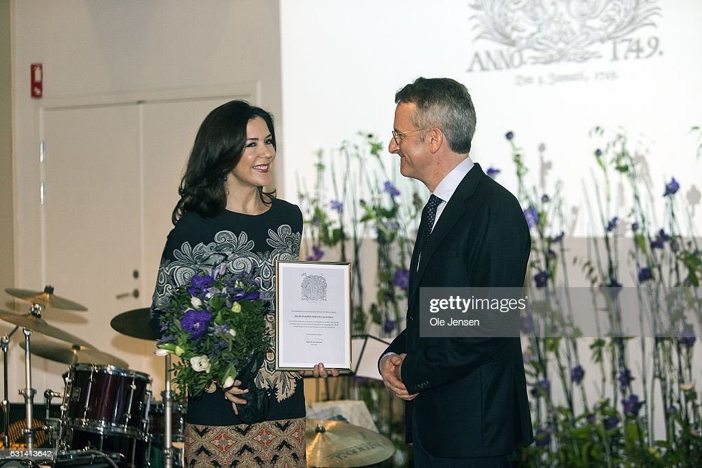Crown Princess Mary receives 'The Berlingske Foundation's' Honorary Award presented by Mads Bryde, chair of 'The Berlingske Foundation' at The Berlingske Media house on January 10, 2017 in Copenhagen, Denmark. Crown Princess Mary receives the honorary award for her 'excellent and consistent work in the service of the Danish society' and in particular her work as protector for and initiator of manifold projects to the benefit of marginalized and vulnerable groups within the society. An important part of her work takes place through The Mary Foundation, which focus area is on isolated children, young vulnerable mothers and violence at home. Berlingske is one of the largest Danish media groups (2 news papers and other print media). The Honorary Award has been given out since 1975. With the award follows 100.000 DKK (13.400 EUR).