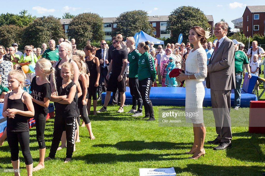 crown-princess-mary-watches-young-gymnast-performing-during-her-visit-picture-id597627400