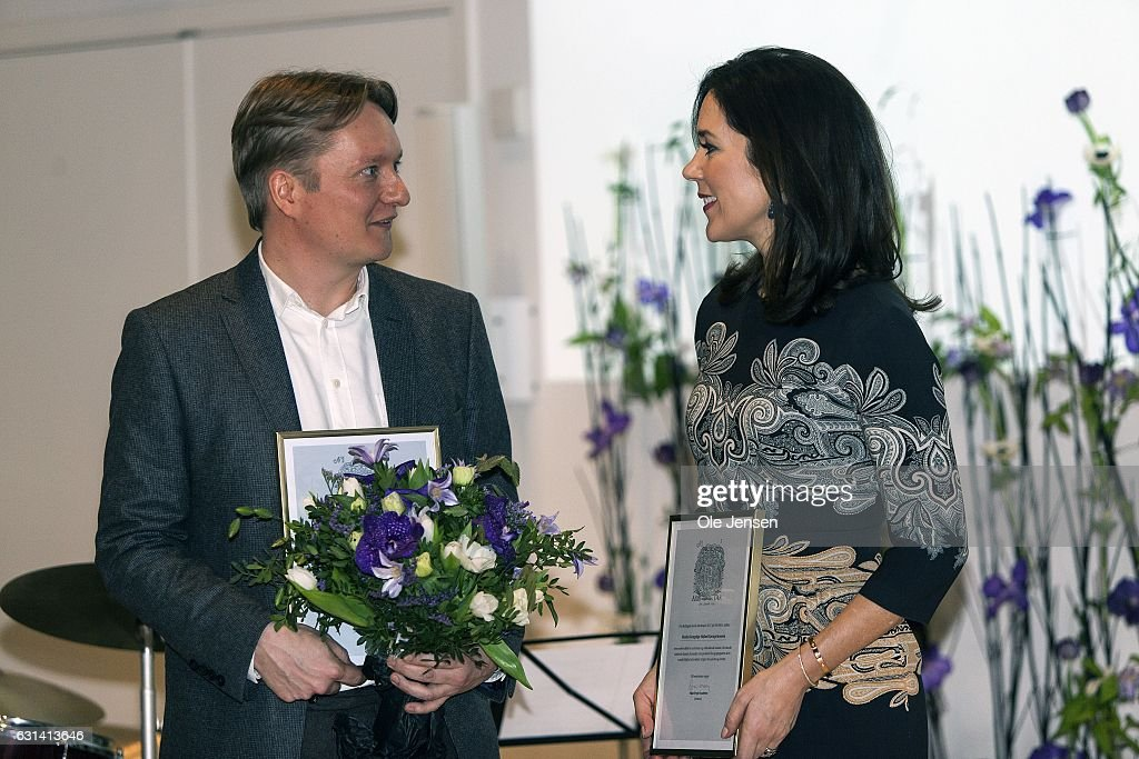 Crown Princess Mary with her Honorary Award given for her work with social vulnerable groups, and journalists Simon Kruse, who was awarded for his coverage of the Ukrainian war at The Berlingske Media house on January 10, 2017 in Copenhagen, Denmark. Berlingske is one of the largest Danish media groups (2 news papers and other print media).